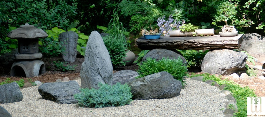 Zen Garden with plants, rocks and a bench