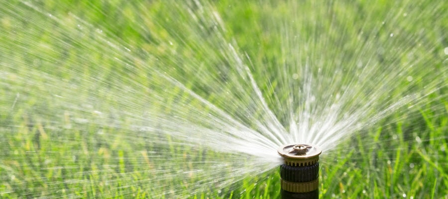 Automated sprinkler system watering lawn