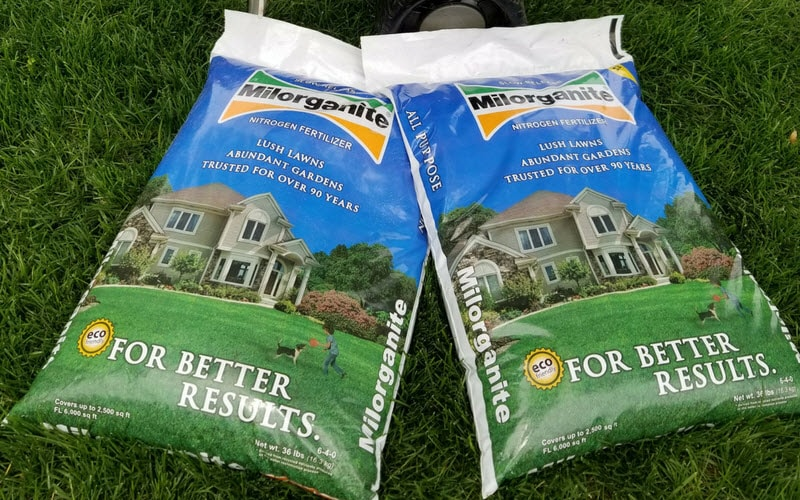 Bags of Milorganite fertilizer in the lawn.