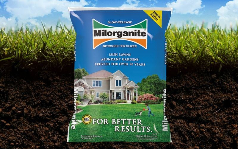 Bag of Milorganite in the lawn and dirt