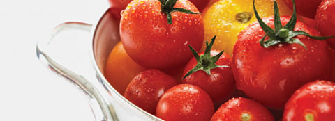 Bright red tomatoes like these can benefit from slow-release fertilizers like Milorganite.