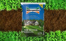Milorganite fertilizer bag in soil and grass